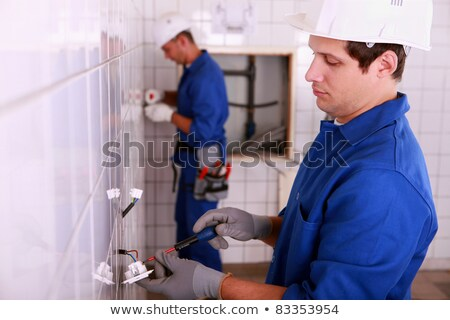 Electrical team wiring a tiled room Stock photo © photography33