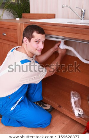 a plumber setting a flexible pipe below a tap Stock photo © photography33
