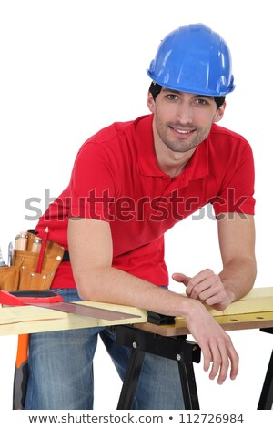 Construction worker leaning against his workbench Stock photo © photography33