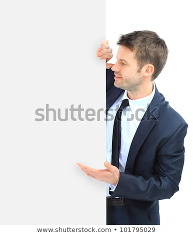 Portrait of young business man showing blank signboard Stock photo © vlad_star