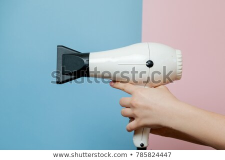 Pink hair dryer in the female hand Stock photo © RuslanOmega