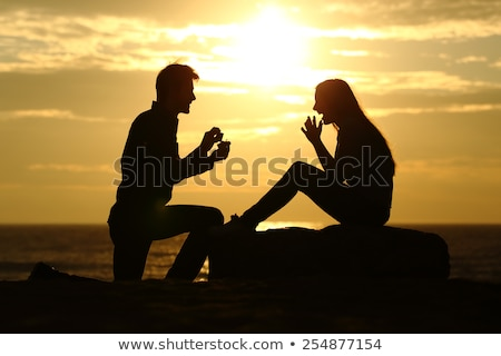 Stock fotó: Férfi · kéz · tengerpart · háttér · nő · égbolt