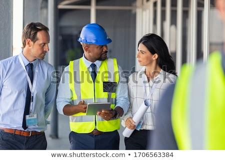 Zdjęcia stock: Discussing Blueprints