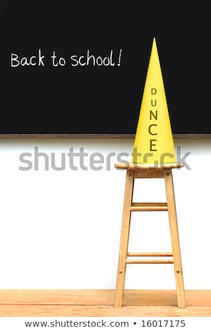 Yellow dunce hat on stool with chalkboard Stock photo © Sandralise