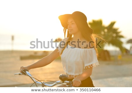 An attractive woman wearing a floppy hat at the beach Stock photo © photography33