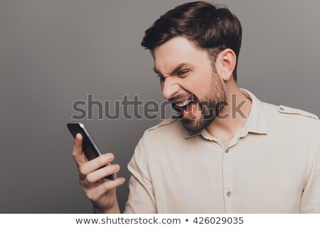 A businessman yelling at his phone. Stock photo © photography33