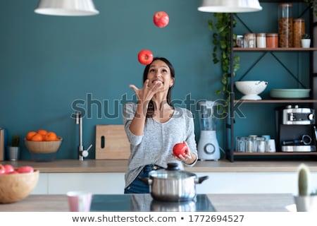 Young brunette juggling fresh apple. Stock photo © lithian