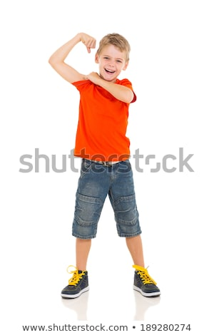 Confident young boy posing in casuals Stock photo © stockyimages