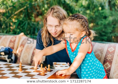 Close-up of toddler playing chess Stock photo © photography33