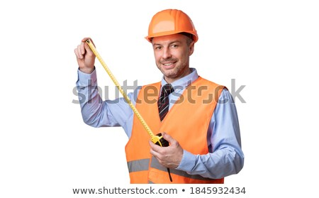 electrician holding a measurement tool and smiling stock photo © photography33