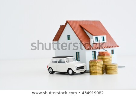 Model car on a pile of coins stock photo © a2bb5s