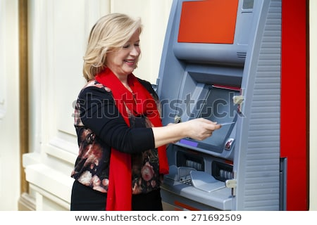 Blond cash machine mooie blond vrouw Stockfoto © ssuaphoto