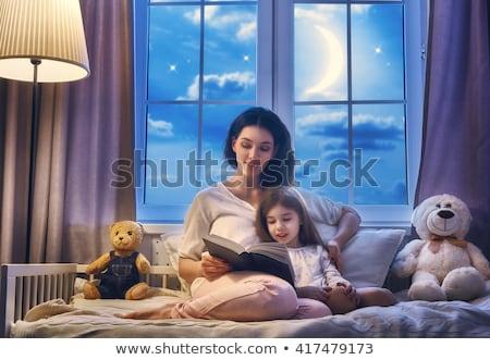 Kislány olvas esti mese fiatal anya szeretet Stock fotó © wavebreak_media