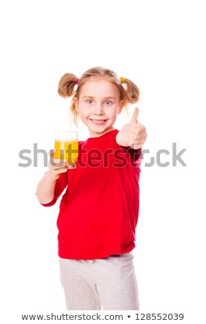 Cute Little Girl Holding Glass With Juice With Thumb Up Foto d'archivio © Len44ik