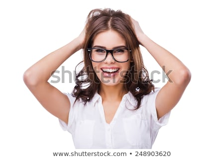 Stock photo: Woman holding hands on her head while smiling