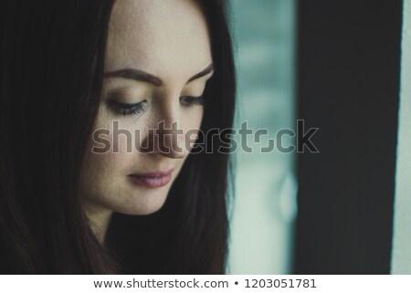 Pallido bruna bellezza guardando verso il basso ritratto femminile Foto d'archivio © wavebreak_media