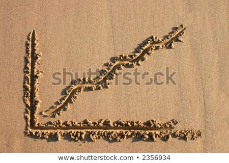 Stock fotó: A Profit Chart Drawn In The Sand