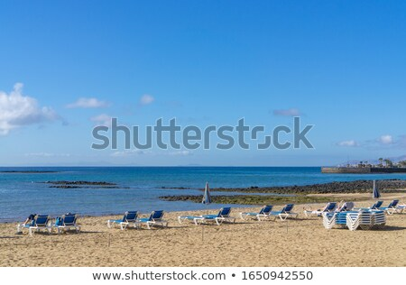 beautiful beach in Arrecife with the town in the background Stock photo © meinzahn
