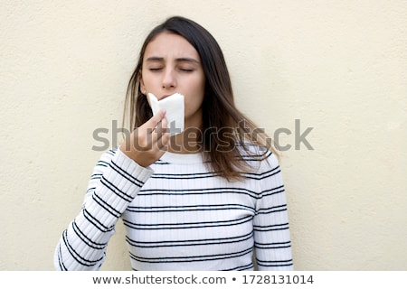 Pretty woman mouth blowing cold breeze Stock photo © ra2studio