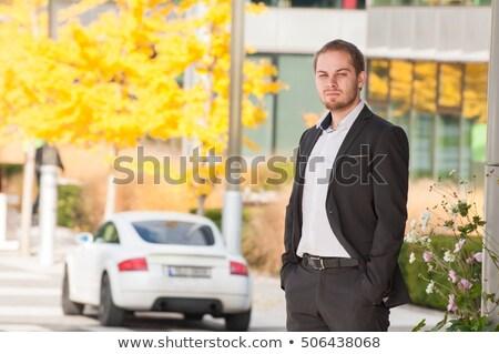 Young woman standing near a sports car holding keys Stock photo © dashapetrenko