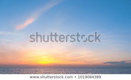 Ardiente puesta de sol cielo verano mar paisaje Foto stock © BSANI
