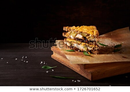 Grains of Seasalt on a Dark Wooden Chopping Board Stock photo © TheFull360
