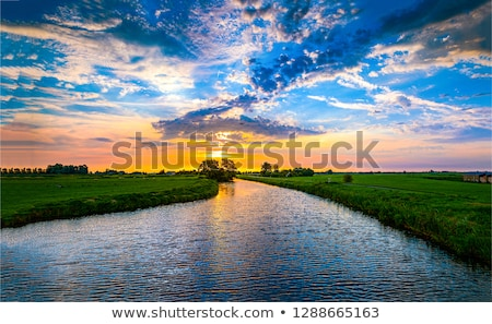 Belo pôr do sol rio paisagem fundo laranja Foto stock © mycola