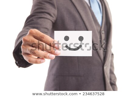 businessman holding business card with smiley face stock photo © stevanovicigor