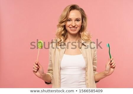 fogmosás · fogszabályozó · közelkép · mosolygó · nő · arc · fehér · fogak - stock fotó © candyboxphoto