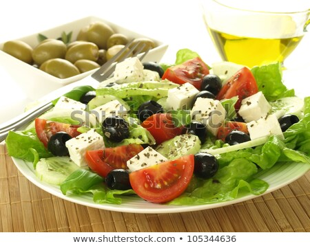Light greek salad with fresh vegetables, garnished with basil.  Stock photo © dariazu