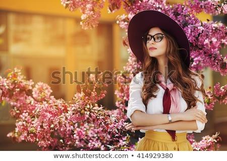 Fiatal gyönyörű nő visel kalap naplemente fény Stock fotó © HASLOO