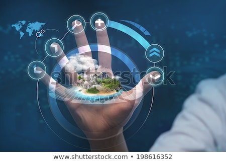 unrecognizable person working holographic city plan stock photo © hasloo