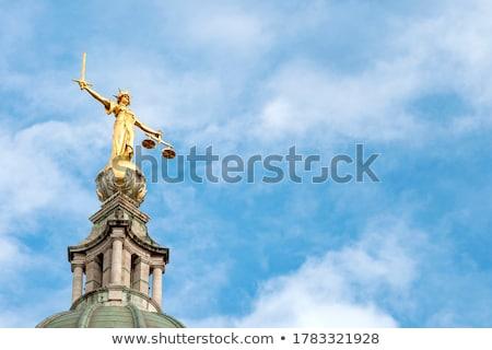 Lady Justice statue against blue sky stock photo © njnightsky