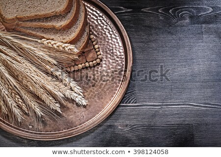brown bread with ears of wheat  Stock photo © OleksandrO