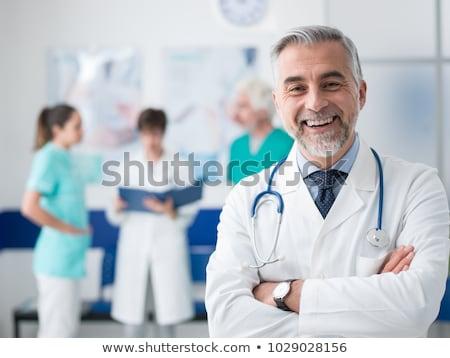 mosolyog · nővér · mér · vérnyomás · beteg · idős - stock fotó © nyul