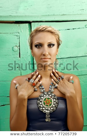 many beautiful rings on tanned hands of a young woman  Stock photo © lubavnel