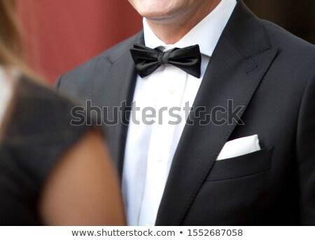 Handsome man in terracotta jacket Stock photo © acidgrey