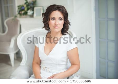 брюнетка · белое · платье · позируют · каменной · стеной · женщину - Сток-фото © acidgrey
