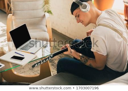 小さな ミュージシャン 若い男 演奏 音楽 ファッション ストックフォト © fatalsweets