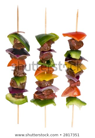 preparing fresh beef steak shishkabobs with vegetables on grill stock photo © tetkoren