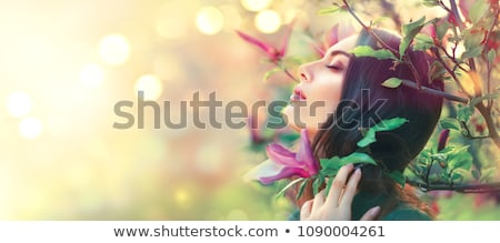 Womans face with green leaves as hair- organic hair care Stock photo © shawlinmohd