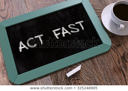 Act Fast - Chalkboard with Hand Drawn Text. Stock photo © tashatuvango