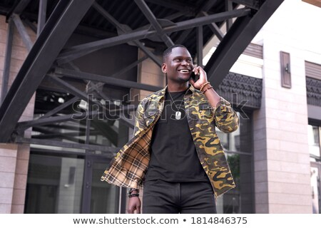 Elegante empresário falante alguém telefone Foto stock © bezikus
