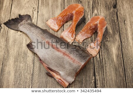 Fresh Norwegian rainbow trout steaks with lemon lies on a wooden background Stock photo © mcherevan