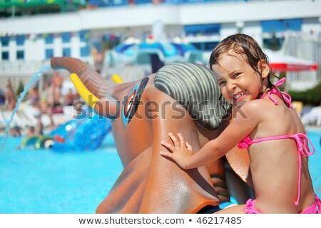 petite · fille · séance · jouet · éléphant · piscine - photo stock © Paha_L