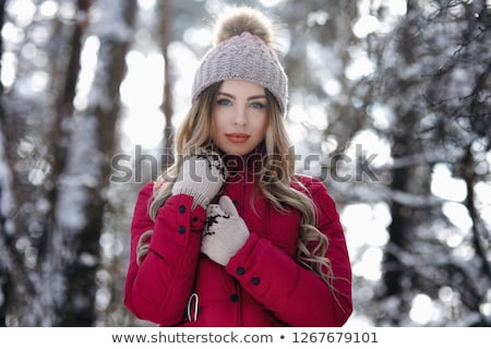smiling beautiful young woman with long hair in winter forest stock photo © deandrobot