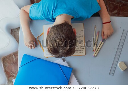 Bored or overworked schoolboy asleep on his desk Stock photo © ozgur