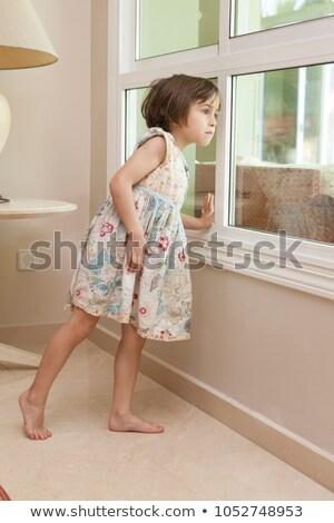 Pretty barefoot girl stands sideways Stock photo © bezikus