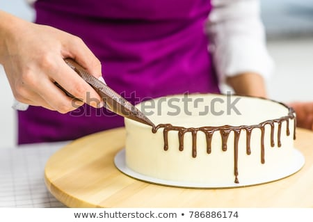 confectioner girl in the pastry shop. cakes on the table. stock photo © natalya_zimina