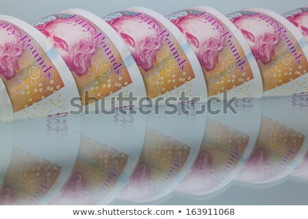 British Fifty pounds on a glass table Stock photo © CaptureLight